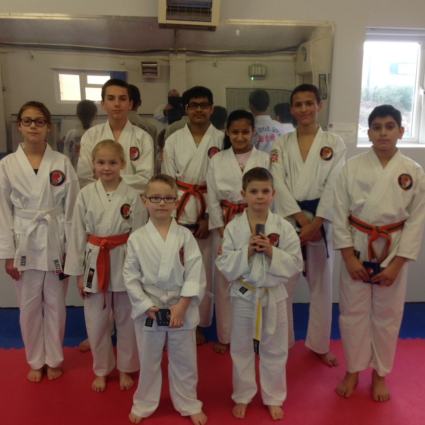 Our Students collecting their new belts acheived